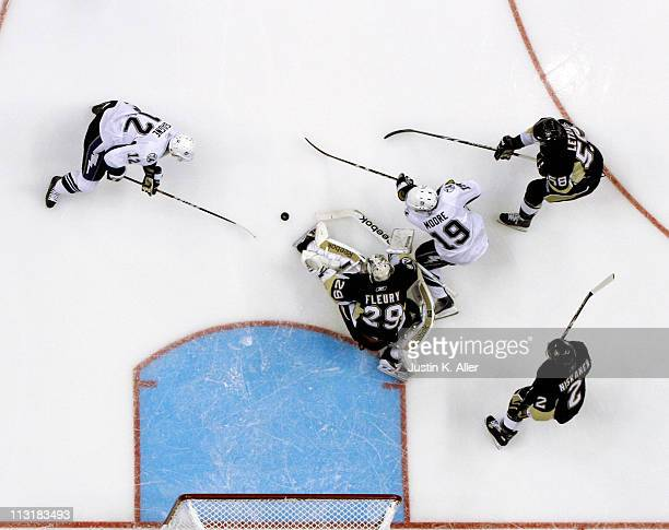 MarcAndre Fleury of the Pittsburgh Penguins makes a save on Dominic Moore and Simon Gagne of the Tampa Bay Lightning as Matt Niskanen and Kris Letang...