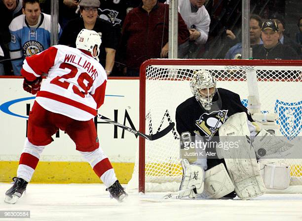 MarcAndre Fleury of the Pittsburgh Penguins makes a save on Jason Williams of the Detroit Red Wings during the shootout at Mellon Arena on January 31...