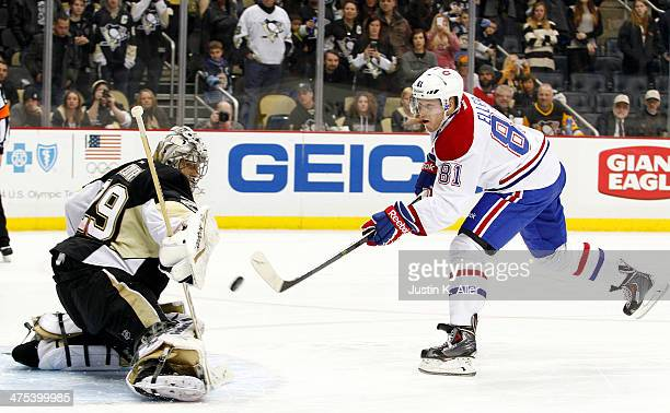 MarcAndre Fleury of the Pittsburgh Penguins makes a save on Lars Eller of the Montreal Canadiens in the shootout during the game at Consol Energy...