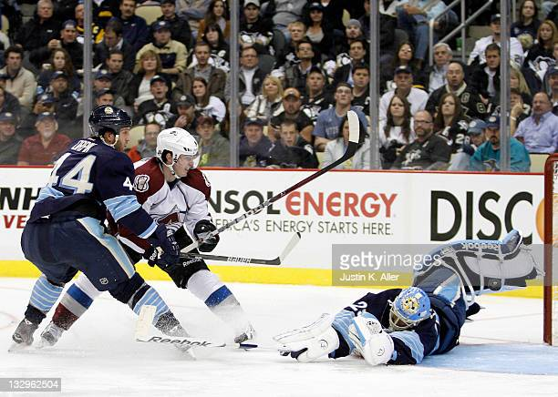 MarcAndre Fleury of the Pittsburgh Penguins makes a save on Matt Duchene of the Colorado Avalanche during the game at Consol Energy Center on...