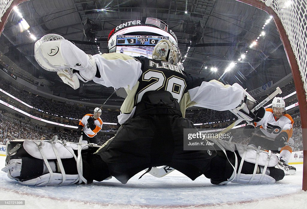 Marc-Andre Fleury #29 of the Pittsburgh Penguins makes a save on Scott Hartnell #19 of the Philadelphia Flyers in Game One of the Eastern Conference Quarterfinals during the 2012 NHL Stanley Cup Playoffs at Consol Energy Center on April 11, 2012 in Pittsburgh, Pennsylvania.