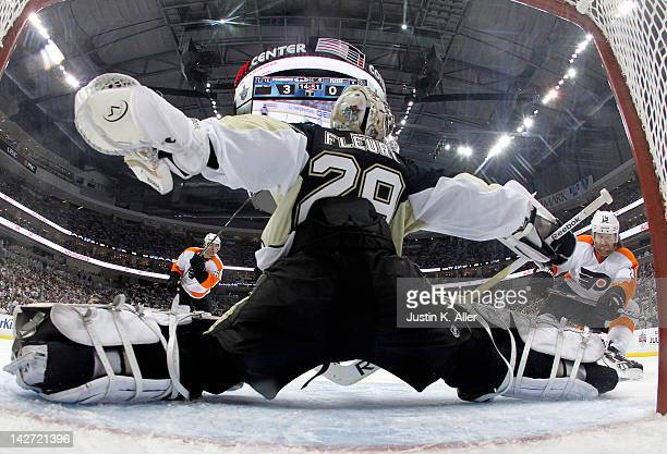 MarcAndre Fleury of the Pittsburgh Penguins makes a save on Scott Hartnell of the Philadelphia Flyers in Game One of the Eastern Conference...