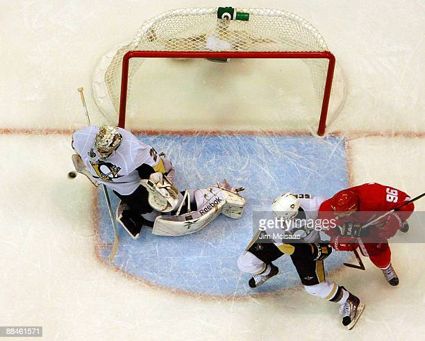 MarcAndre Fleury of the Pittsburgh Penguins makes a save with one second left in the game against the Detroit Red Wings during Game Seven of the 2009...