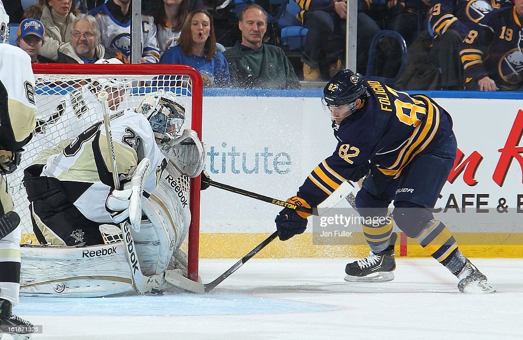 Marc-Andre Fleury #29 of the Pittsburgh Penguins makes a third period save on Marcus Foligno #82 of the Buffalo Sabres on February 17, 2013 at the First Niagara Center in Buffalo, New York. Pittsburgh defeated Buffalo, 4-3.