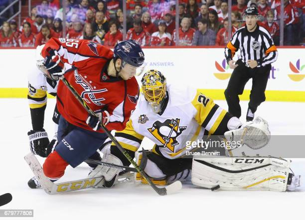 MarcAndre Fleury of the Pittsburgh Penguins makes the first period save on Andre Burakovsky of the Washington Capitals in Game Five of the Eastern...