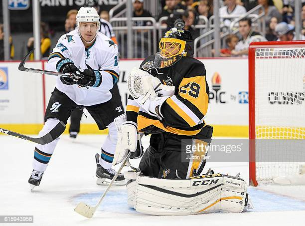 MarcAndre Fleury of the Pittsburgh Penguins makes the save against the San Jose Sharks in the third period during the game at PPG PAINTS Arena on...