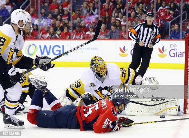 MarcAndre Fleury of the Pittsburgh Penguins makes the save on Andre Burakovsky of the Washington Capitals in Game Five of the Eastern Conference...