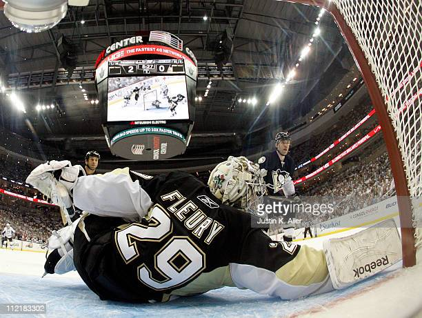 MarcAndre Fleury of the Pittsburgh Penguins protects the net against the Tampa Bay Lightning in Game One of the Eastern Conference Quarterfinals...