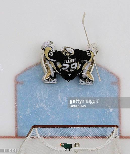 MarcAndre Fleury of the Pittsburgh Penguins protects the net against the Washington Capitals during the game at Consol Energy Center on February 7...