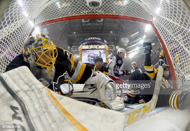 MarcAndre Fleury of the Pittsburgh Penguins protects the net against Josh Anderson of the Columbus Blue Jackets in Game Five of the Eastern...