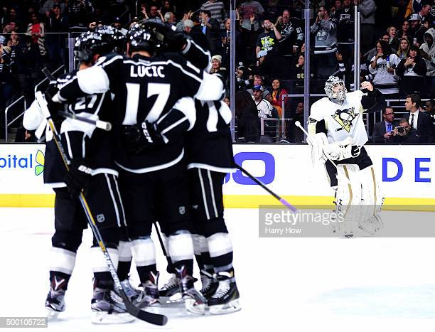 MarcAndre Fleury of the Pittsburgh Penguins reacts after a goal from Milan Lucic of the Los Angeles Kings to trail 30 during the second period at...