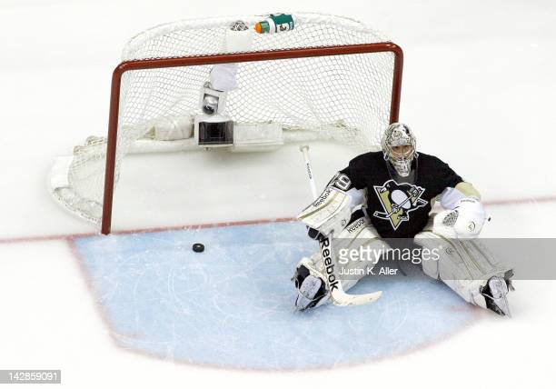 MarcAndre Fleury of the Pittsburgh Penguins reacts after giving up a goal in the third period against the Philadelphia Flyers in Game Two of the...