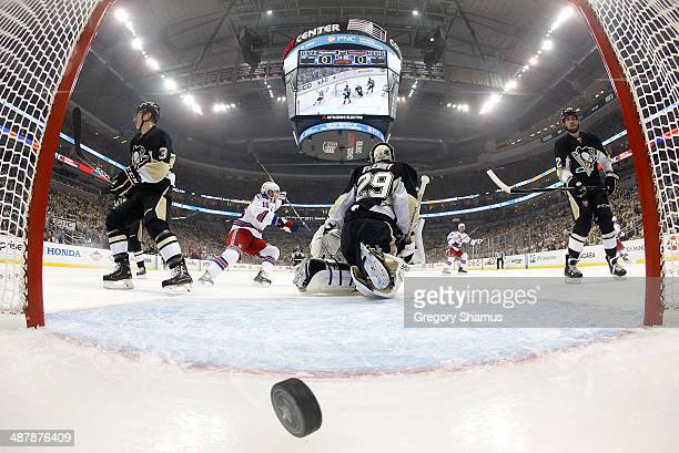 Marc-Andre Fleury of the Pittsburgh Penguins reacts after giving up a goal by Benoit Pouliot of the New York Rangers in Game One of the Second Round...