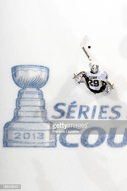MarcAndre Fleury of the Pittsburgh Penguins skates with the puck during warmup prior to the game against the Ottawa Senators in Game Four of the...