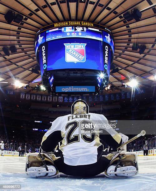 MarcAndre Fleury of the Pittsburgh Penguins takes a break during the game against the New York Rangers in Game One of the Eastern Conference...