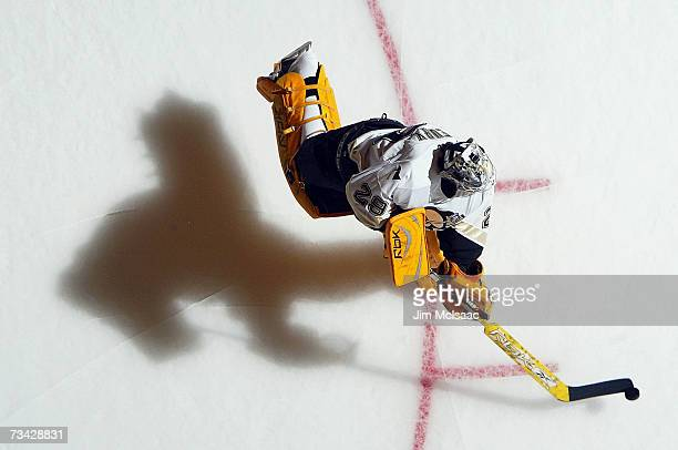 MarcAndre Fleury of the Pittsburgh Penguins warms up before the game against the New York Islanders on February 19 2007 at Nassau Coliseum in...