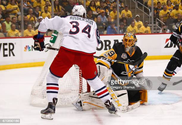 MarcAndre Fleury of the Pittsburgh Penguins watches the puck after a shot by Josh Anderson of the Columbus Blue Jackets during the first period in...