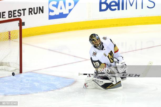 MarcAndre Fleury of the Vegas Golden Knights allows a first period goal to Dustin Byfuglien of the Winnipeg Jets in Game One of the Western...
