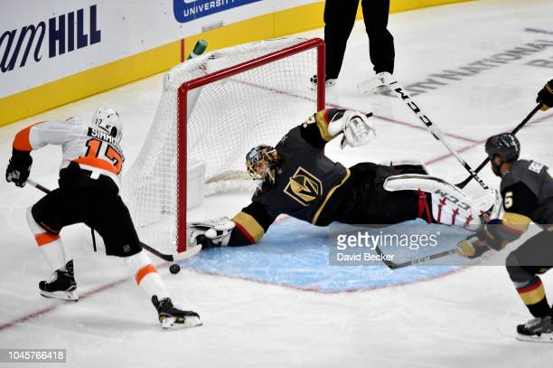 MarcAndre Fleury of the Vegas Golden Knights attempts to save a shot by Wayne Simmonds of the Philadelphia Flyers during a game at TMobile Arena on...