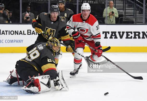 MarcAndre Fleury of the Vegas Golden Knights blocks a Carolina Hurricanes' shot in front of Brad Hunt of the Golden Knights and Andrei Svechnikov of...