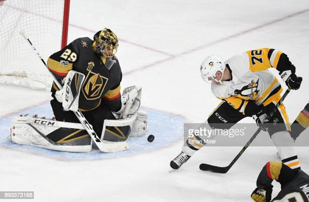 MarcAndre Fleury of the Vegas Golden Knights blocks a Pittsburgh Penguins shot as Patric Hornqvist of the Penguins waits for a rebound in the second...