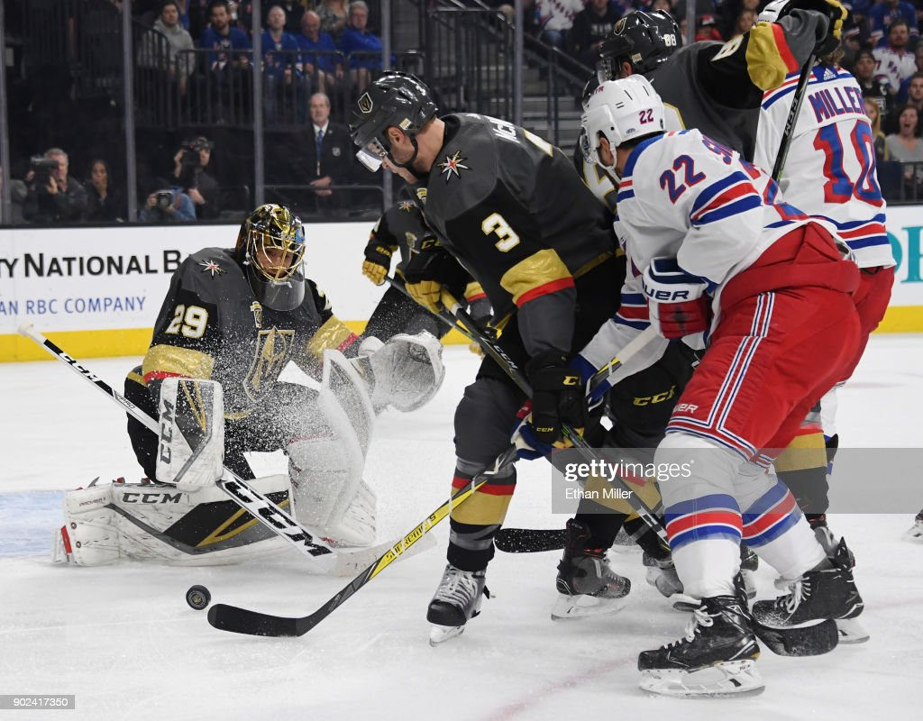 Marc-Andre Fleury #29 of the Vegas Golden Knights blocks a shot as Brayden McNabb #3 of the Golden Knights and Kevin Shattenkirk #22 of the New York Rangers wait for a rebound in the first period of their game at T-Mobile Arena on January 7, 2018 in Las Vegas, Nevada. The Golden Knights won 2-1.