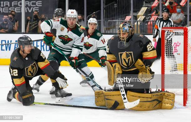 Marc-Andre Fleury of the Vegas Golden Knights blocks a shot as Kirill Kaprizov of the Minnesota Wild looks for a rebound against Nick Holden of the...