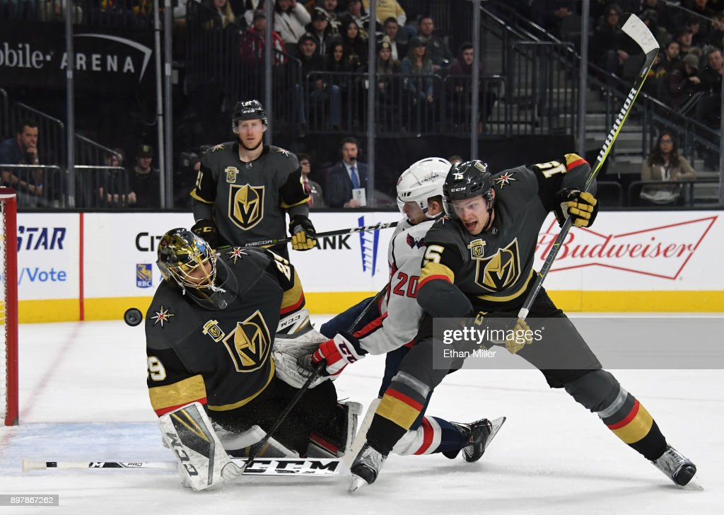 Marc-Andre Fleury #29 of the Vegas Golden Knights blocks a shot as Lars Eller #20 of the Washington Capitals and Jon Merrill #15 of the Golden Knights battle in front of the net during the third period of their game at T-Mobile Arena on December 23, 2017 in Las Vegas, Nevada. The Golden Knights won 3-0.