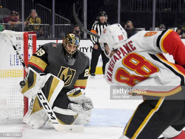 Marc-Andre Fleury of the Vegas Golden Knights blocks a shot by Andrew Mangiapane of the Calgary Flames in the first period of their game at T-Mobile...