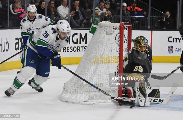 MarcAndre Fleury of the Vegas Golden Knights blocks a shot by Brandon Sutter of the Vancouver Canucks in the first period of their game at TMobile...