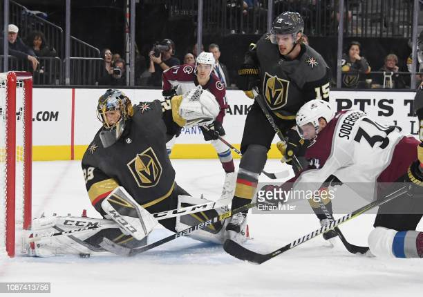 MarcAndre Fleury of the Vegas Golden Knights blocks a shot by Carl Soderberg of the Colorado Avalanche as Jon Merrill of the Golden Knights defends...