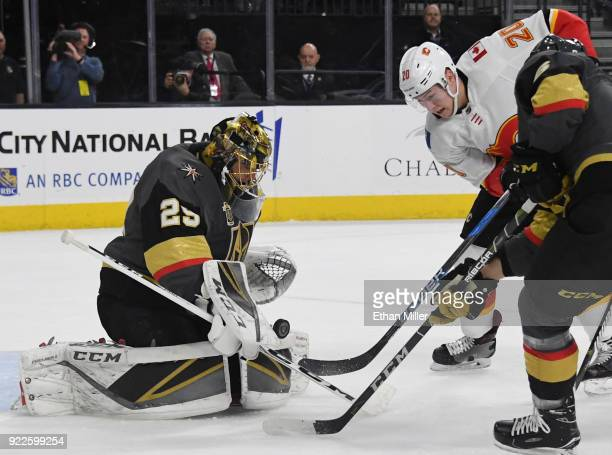 MarcAndre Fleury of the Vegas Golden Knights blocks a shot by Curtis Lazar of the Calgary Flames in the first period of their game at TMobile Arena...