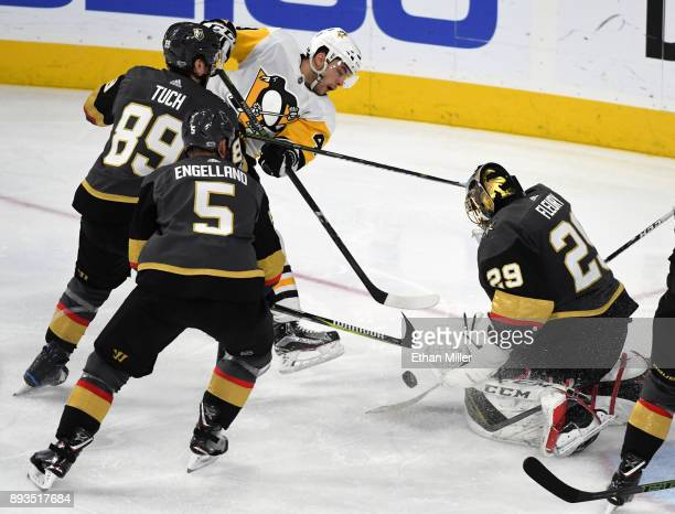 MarcAndre Fleury of the Vegas Golden Knights blocks a shot by Dominik Simon of the Pittsburgh Penguins as Alex Tuch and Deryk Engelland of the Golden...
