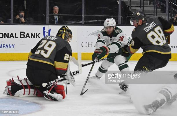 MarcAndre Fleury of the Vegas Golden Knights blocks a shot by Jason Zucker of the Minnesota Wild as Nate Schmidt of the Golden Knights defends in the...