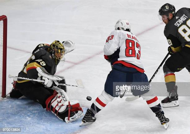 MarcAndre Fleury of the Vegas Golden Knights blocks a shot by Jay Beagle of the Washington Capitals as Nate Schmidt of the Golden Knights defends in...