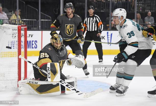 MarcAndre Fleury of the Vegas Golden Knights blocks a shot by Logan Couture of the San Jose Sharks in the first period of their preseason game at...