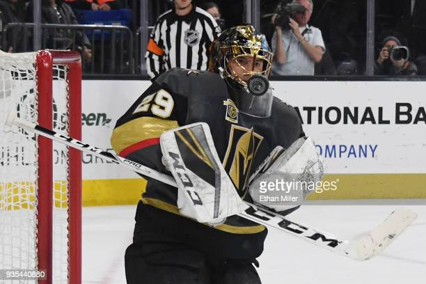 MarcAndre Fleury of the Vegas Golden Knights blocks a shot by Nic Dowd of the Vancouver Canucks in the first period of their game at TMobile Arena on...
