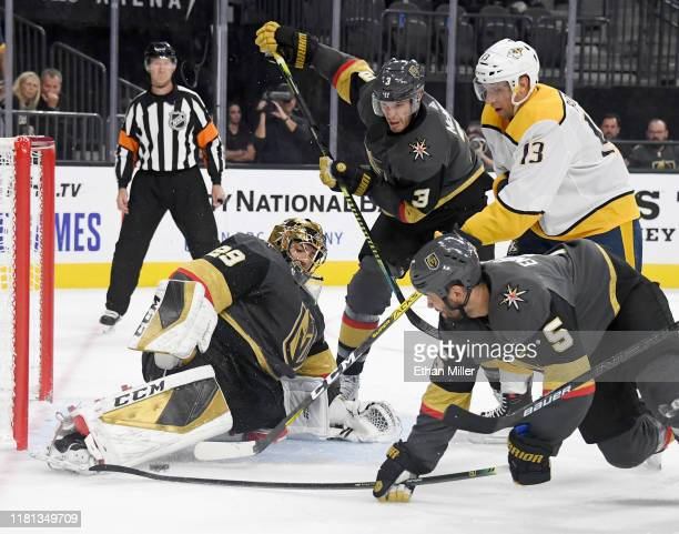 Marc-Andre Fleury of the Vegas Golden Knights blocks a shot by Nick Bonino of the Nashville Predators as Brayden McNabb and Deryk Engelland of the...