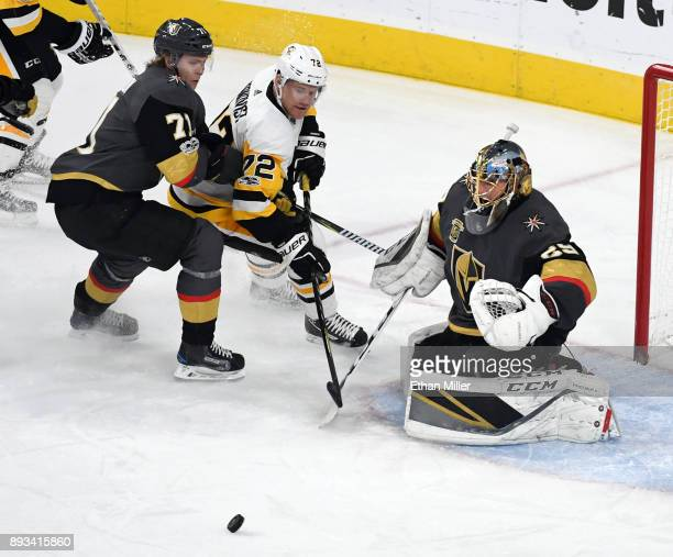 MarcAndre Fleury of the Vegas Golden Knights blocks a shot by Patric Hornqvist of the Pittsburgh Penguins as William Karlsson of the Golden Knights...