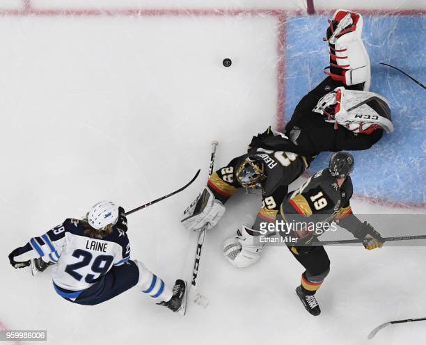 MarcAndre Fleury of the Vegas Golden Knights blocks a shot by Patrik Laine of the Winnipeg Jets as Reilly Smith of the Golden Knights defends in the...