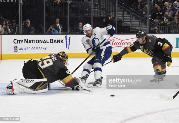 MarcAndre Fleury of the Vegas Golden Knights blocks a shot by Steven Stamkos of the Tampa Bay Lightning as Brayden McNabb of the Golden Knights...