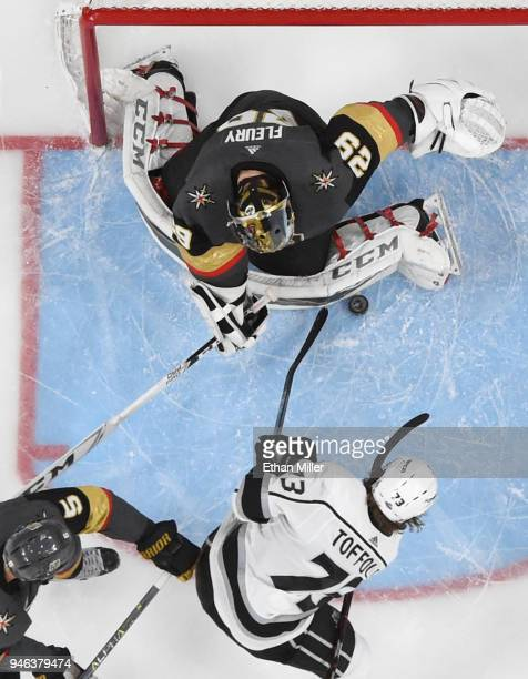 MarcAndre Fleury of the Vegas Golden Knights blocks a shot by Tyler Toffoli of the Los Angeles Kings as Deryk Engelland of the Golden Knights defends...