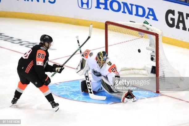 MarcAndre Fleury of the Vegas Golden Knights blocks a shot from Patrick Kane of the Chicago Blackhawks during the first half 2018 Honda NHL AllStar...