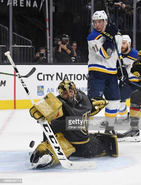 Marc-Andre Fleury of the Vegas Golden Knights blocks a St. Louis Blues' shot as Tyler Bozak of the Blues waits for a rebound in the third period of...