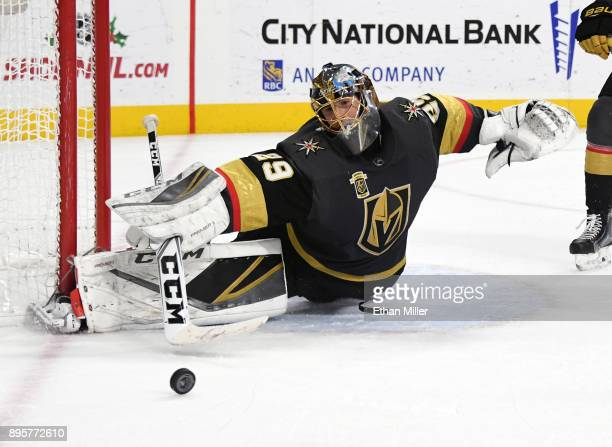 MarcAndre Fleury of the Vegas Golden Knights blocks a Tampa Bay Lightning shot in the third period of their game at TMobile Arena on December 19 2017...
