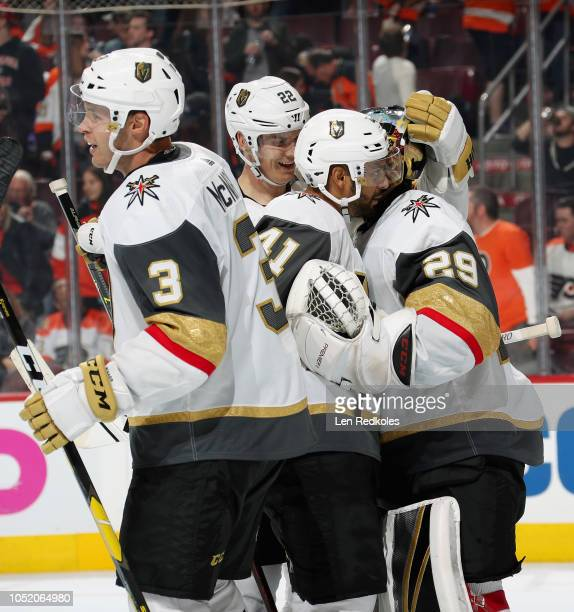 MarcAndre Fleury of the Vegas Golden Knights celebrates with teammates Brayden McNabb Nick Holden and PierreEdouard Bellemare after defeating the...