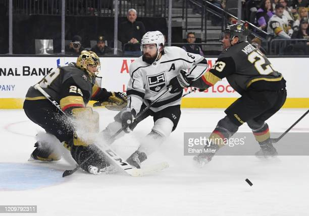 MarcAndre Fleury of the Vegas Golden Knights comes out of the crease to block a shot by Drew Doughty of the Los Angeles Kings as Alec Martinez of the...