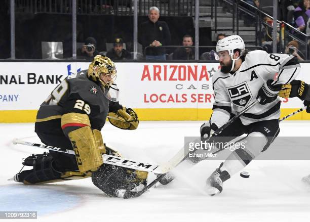 MarcAndre Fleury of the Vegas Golden Knights comes out of the crease to block a shot by Drew Doughty of the Los Angeles Kings in the first period of...