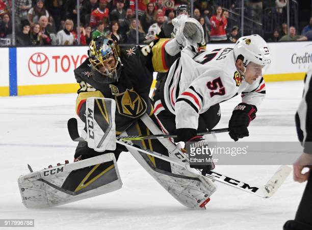 MarcAndre Fleury of the Vegas Golden Knights comes out of the crease to hit Tommy Wingels of the Chicago Blackhawks in the first period of their game...
