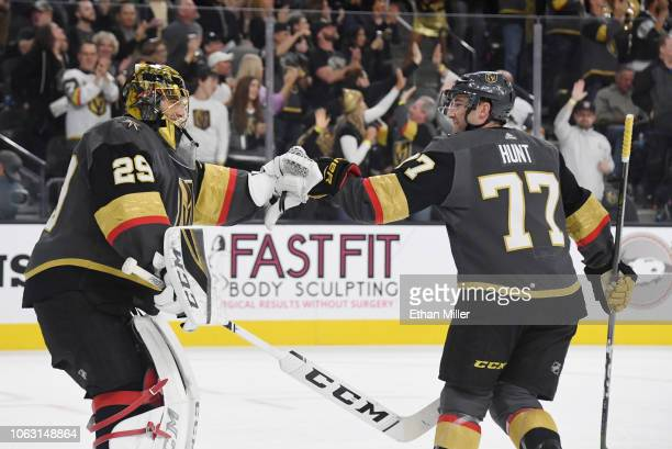 MarcAndre Fleury of the Vegas Golden Knights congratulates Brad Hunt after he scored a firstperiod goal against the Carolina Hurricanes during their...